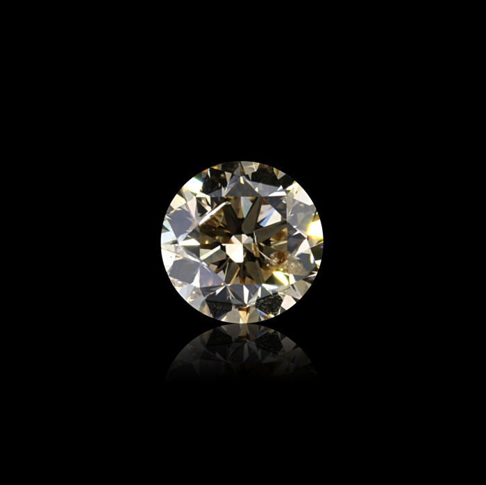 0.70 Ct. Natural O Color Round Brilliant cut diamond. EXEXEX