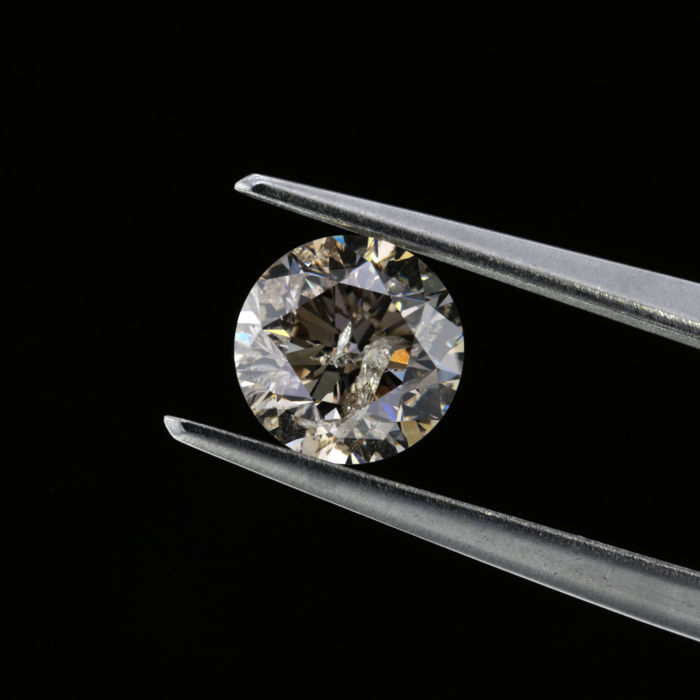 0.94 Ct. Natural O Color Round Brilliant cut diamond.