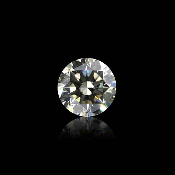 0.53 Ct. Natural O Color Round Brilliant cut diamond.