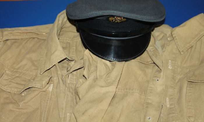 Two original British World war II Bush shirts, one dated 1943, makers mark in fair condition, and a RAF peaked cap,in good  condition