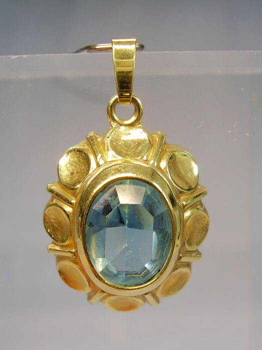 Antique golden pendant with faceted light blue spinel, signed Kordes & Lichtenfels