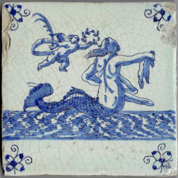 Very rare 17th century tile with a depiction of a sea creature and Amor - Intact