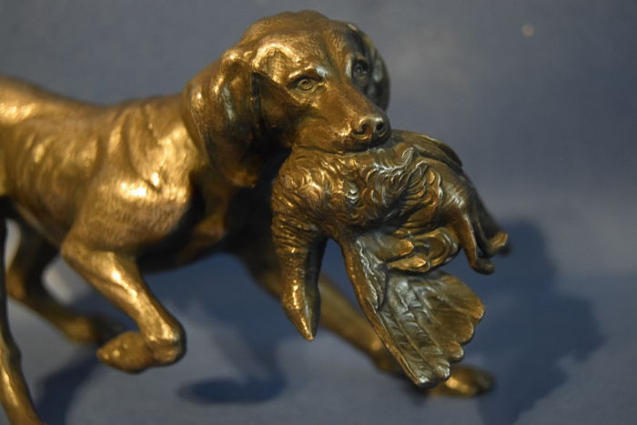 A well detailed statue depicting a hunting dog with a pheasant - marked WMF - Germany -  early 20th century