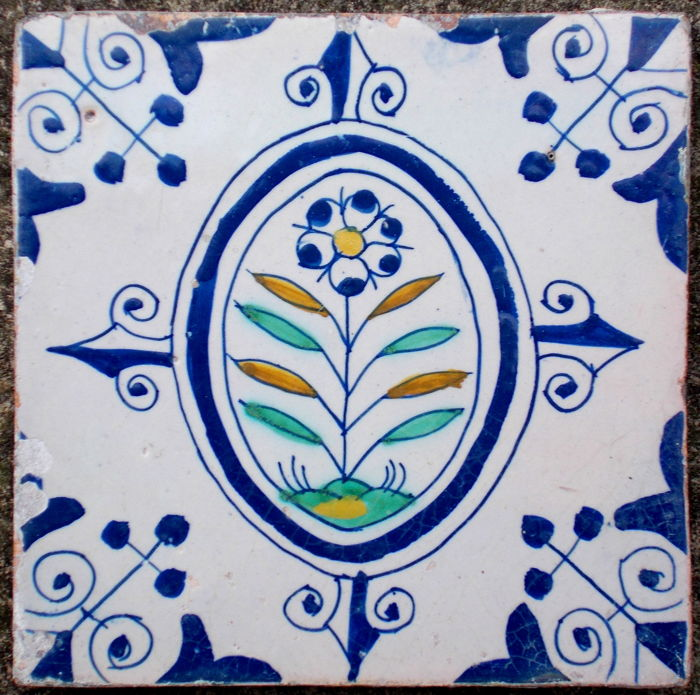 Rare, super intact tile with a flower, Holland, ca. 1620-1640