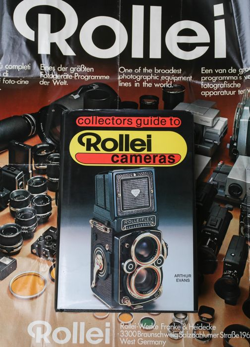 Collector's Guide to Rollei Cameras (Hardcover) by Arthur G. Evans with a Rollei advertising poster from the 1970s