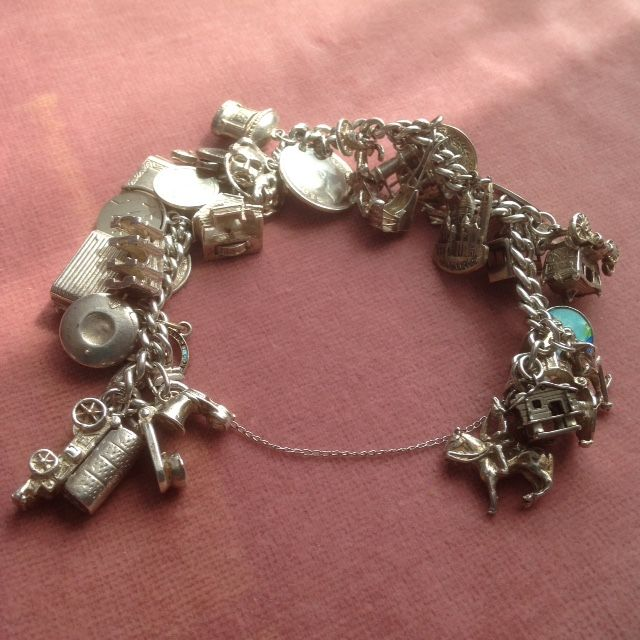 Substantial Silver Charm Bracelet with 27 Silver Charms   Pendants and  Safety Chain 1b62563f5