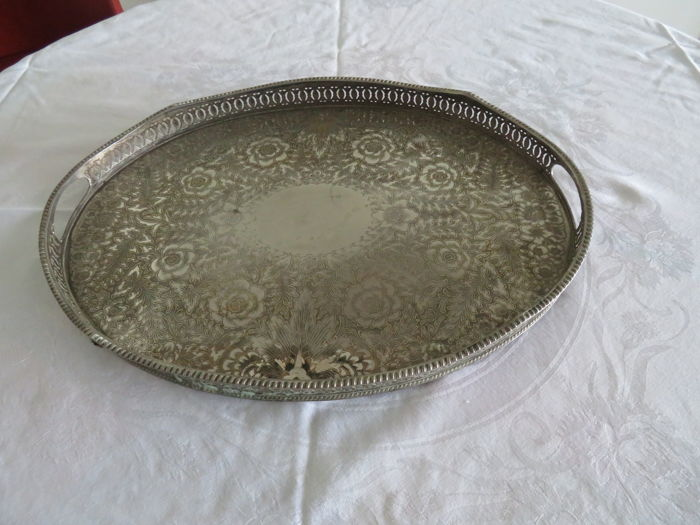 Heavy silver serving dish with floral pattern, marked