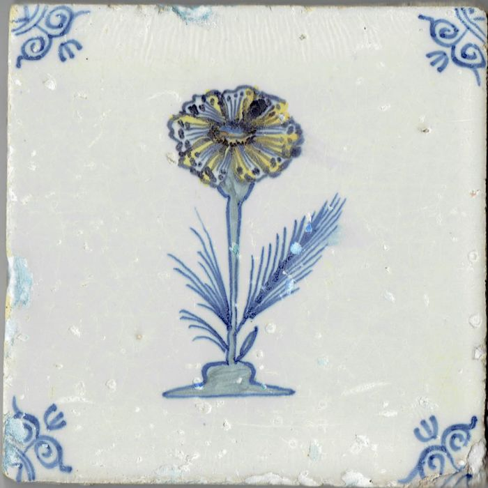 Nice 17th century tile with a depiction of a cornflower