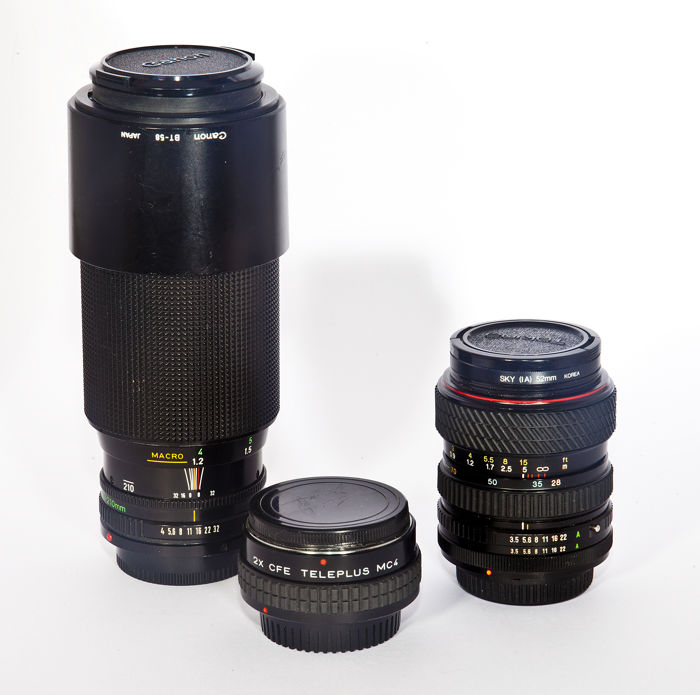Canon AE-1 Program with Canon 70-210 and Tokina 28-70 lenses plus Teleplus 2x converter.