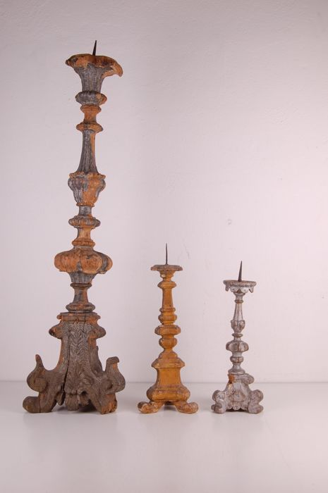 Three wooden candlesticks from the late 1800s
