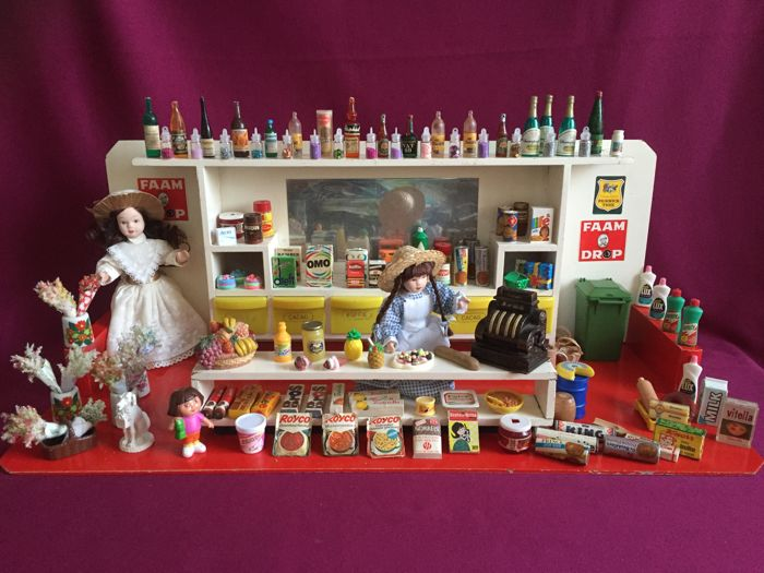 wooden grocery store flower shop with lots of items and 2 porcelain