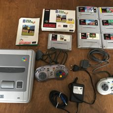Nintendo SNES with 7 Games (FIFA 96, Doom, F1 and more) and accessories