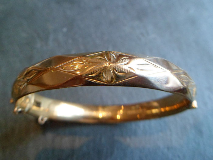Heavy Antique ornate  bangle with safety chain. No reserve