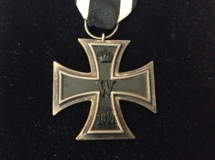 Iron Cross 2nd class, field cross of merit with swords for fighters and a button hole clasp to the field cross of merit