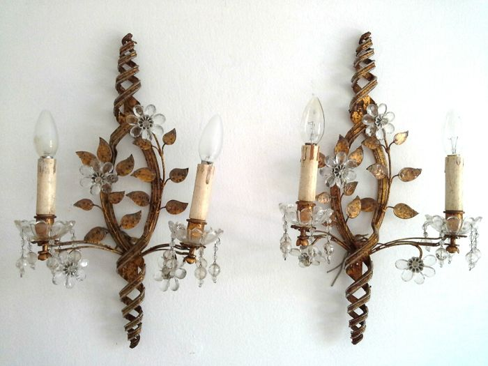 Pair of French Maison Bagues wall lights - two arm light sconces of gilt bronze beaded helix frames with clear rock crystal pearls, glass flowers and branches of gold leaves - 1930s, France