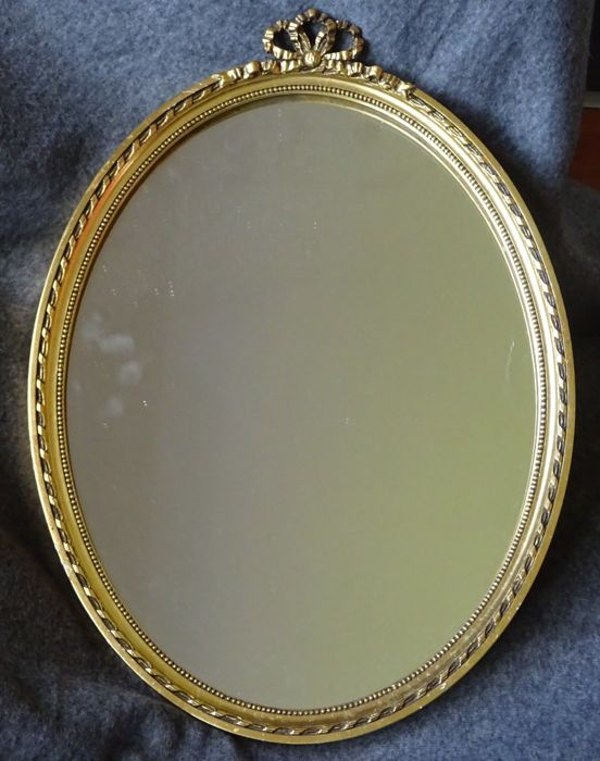 Beautiful oval hall mirror with beaded gold-coloured frame