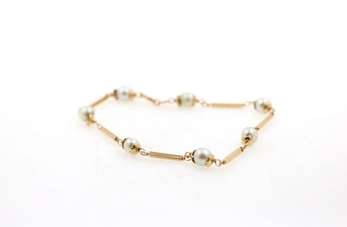 18 kt yellow gold bracelet with salt water cultivated pearls - length: 20 mm