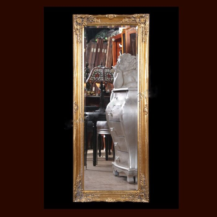 A very large, antique mirror in a golden, wooden frame - hand-made Poland