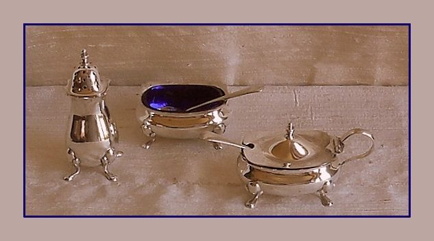 Sterling silver condiment set, Mappin & Webb, Birmingham, 1926 and two spoons, Joseph Rodgers, Birmingham, 1908 and James Dixon, Sheffield, 1895