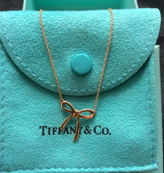"""Tiffany & Co 18k Yellow Gold Mini Bow Pendant and 16"""" chain."""