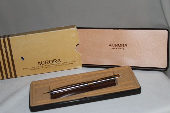 Aurora Marco Polo satin chrome ballpoint pen, with golden finishes, box and case, Italy, second half of the 20th century