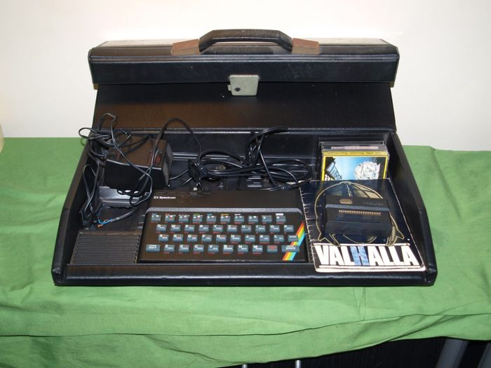 Sinclair zx spectrum 48k  in carry case with 3 games power supply all working