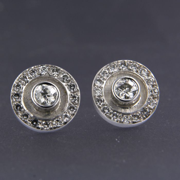 14 kt white gold ear studs set in the centre with an old European cut diamond and 32 brilliant cut diamonds of approx.1.50 carat in total