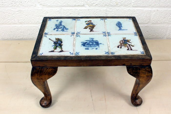 A side table with six inlaid antique ceramic tiles with pictures, 1st half 1900, Netherlands