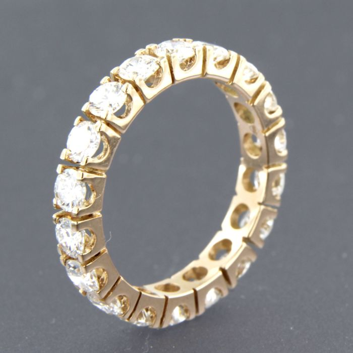 18 kt yellow gold full eternity ring set with 21 brilliant cut diamonds, approx. 1.05 carat in total