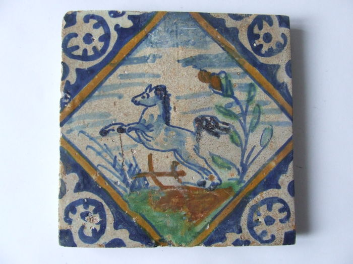 Antique square tile from Zeeland with a prancing horse