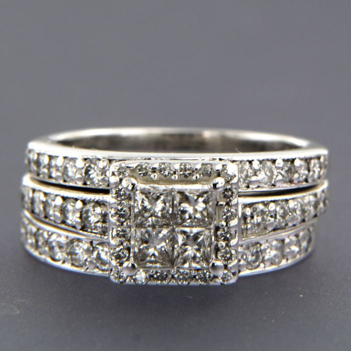 14 kt white gold ring with two stacking rings, set with princess and brilliant cut diamonds, approx. 1.27 ct in total