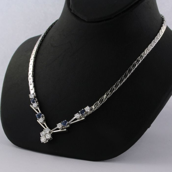 18 kt white gold necklace set with brilliant cut diamonds and sapphires, necklace length 42 cm