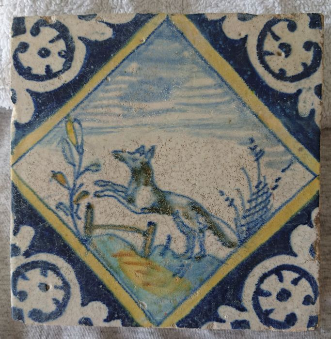 17th century square tile with a jumping dog