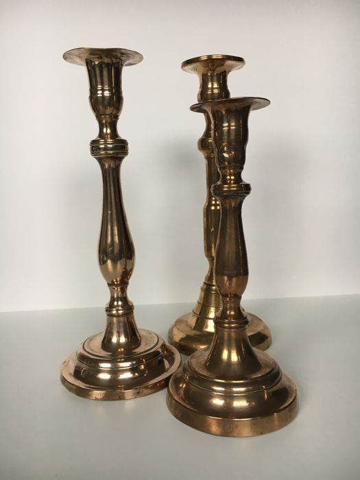 Set of three copper candlesticks, Belgian made, around 1905