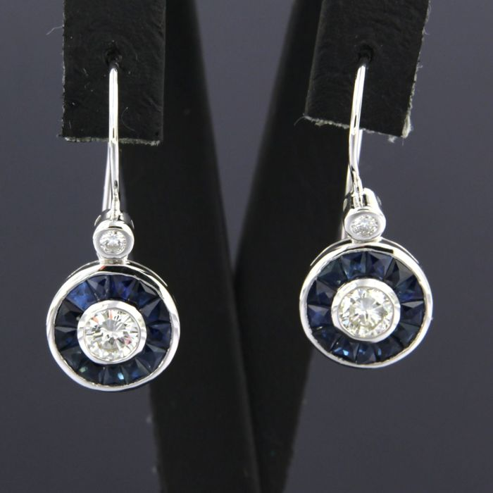 14 kt white gold dangle earrings set with sapphires and brilliant-cut diamond, approximately 0.60 ct in total