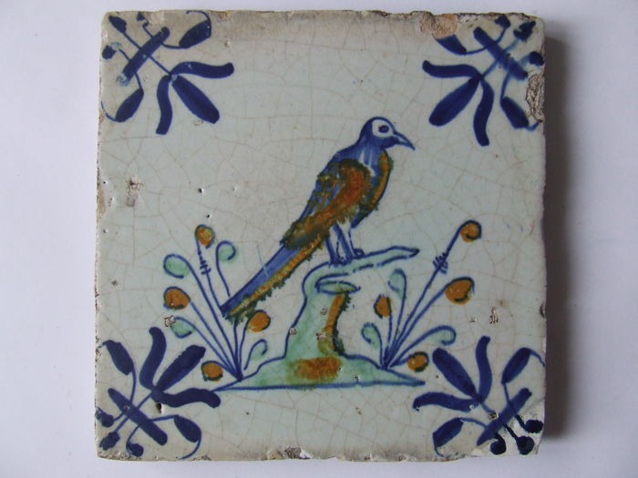 Coloured Gouda tile with a magpie on a tree branch