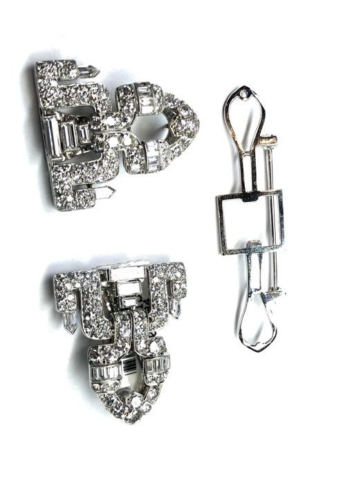 white gold detachable brooch ,18karat gold with 4.40 carat round and baguette cut diamonds.can be worn as pendent.