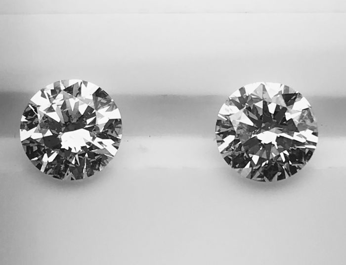 Pair of Round Brilliant in total weight of 2.00 ct 1.00ct H SI2 -1.00ct I SI2  - #2681-2682