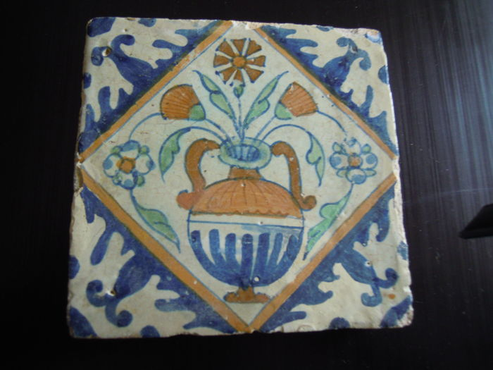 Multicoloured square tile with a flower vase