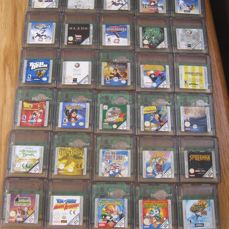 30 Gameboy Color games some are rare games like: Super mario bros deluxe + +Hanos off time + Spirou + Dragon bal Z and more