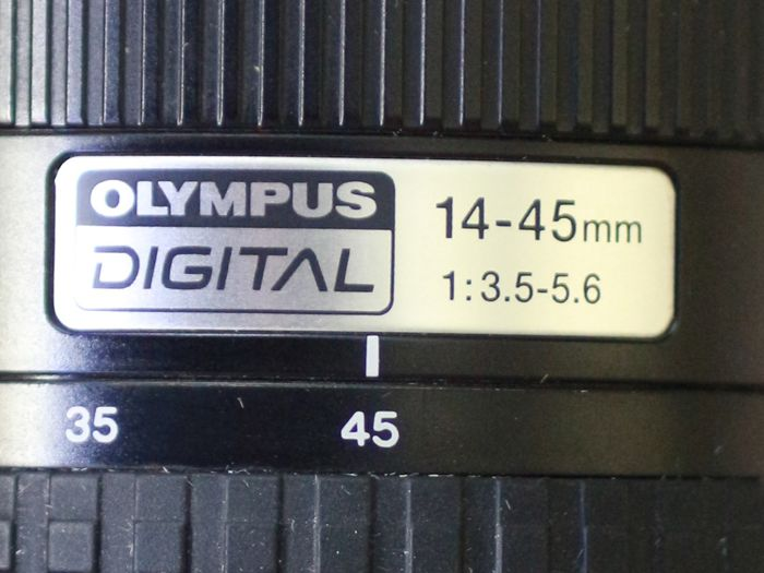 Lens Olympus digital 14-45mm  1: 3.5-5.6  - brand new - with caps
