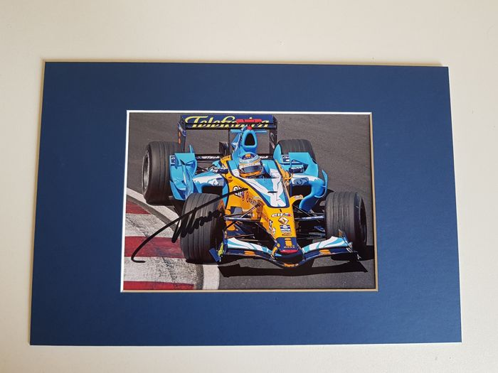 Fernando Alonso - 2x Worldchampion Formula 1 and winner 24 hours Le Mans 2018 - hand signed photo + COA.