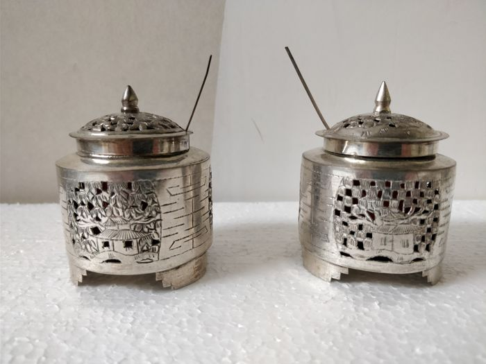 pair of silver mustard pots with fine carving and openwork with decorations of a Vietnam scene - around 1920