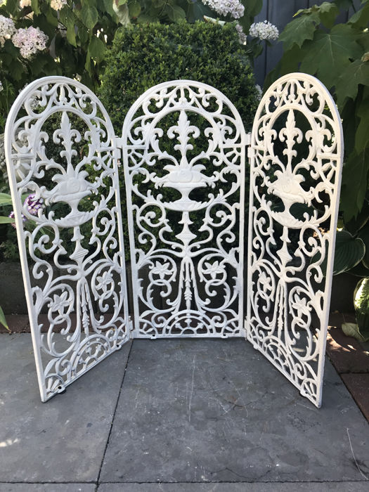 Detailed screen cast iron triptych