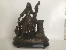 A burnished metal/spelter sculpture on a stand depicting Jeanne 'd Arc or Joan of Arc, France, circa 1890