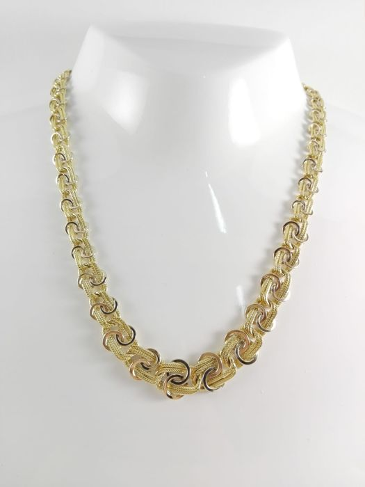 "Women's necklace in 18 kt white and yellow gold by ""L' Indiana"" with decreasing size links Weight: 11.7 g"
