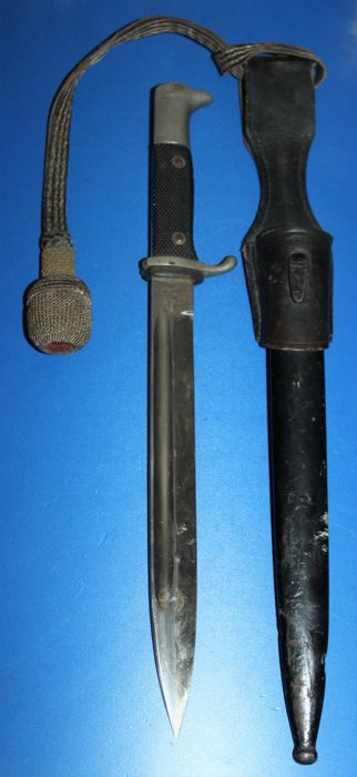 WW2 German  dress Bayonet  with scabbard,and portepee/ troddel textured composite grip, 25cm blade marked E. Pack & Söhne Solingen, total length 40cm, in good condition