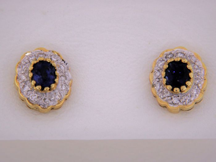 18 kt gold earrings with sapphires - entourage of diamonds