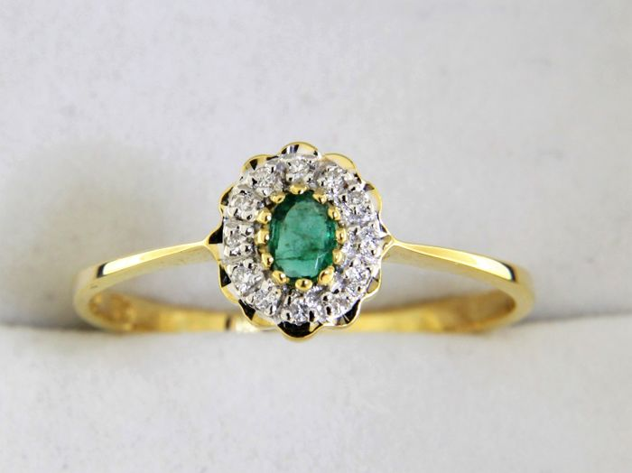 18 kt gold jewellery ring with an emerald and diamonds, size 51