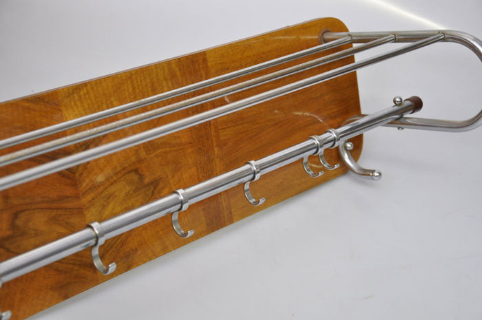 Producer Unknown Chrome Tube Metal Coat Rack On A Wooden Wall Cool Wooden Wall Coat Rack